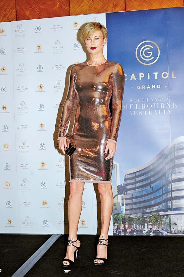 South African-American actress Charlize Theron poses as she arrives for a promotional event for Australia's first six-star residential and luxury retail precinct Capitol Grand tower as the brand ambassador in Hong Kong, China, 28 October 2015., Image: 264193736, License: Rights-managed, Restrictions: This content is restricted from viewing without proper permissions due to fine art copyright or its sensitive nature. Not available for distribution or use by resellers/representatives in the United States. Not available for license and invoicing to customers located in mainland China. Not available for license and invoicing to customers located in Belgium. Not available for license and invoicing to customers located in the Netherlands. Not available for license and invoicing to customers located in Taiwan. Not available for license and invoicing to customers located in France., Model Release: no, Credit line: Profimedia, Corbis Splash (login required images)