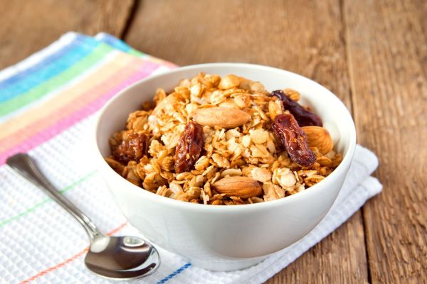 delicious and healthy wholegrain muesli breakfast, with lots of dry fruits, nuts and grains close up, horizontal, on wooden table with spoon, Image: 170255575, License: Royalty-free, Restrictions: , Model Release: no, Credit line: Profimedia, Alamy