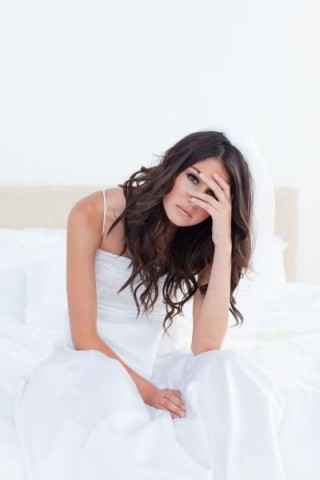 Young sad betrothed woman sitting on the bed in a bright room, Image: 138451709, License: Royalty-free, Restrictions: , Model Release: yes, Credit line: Profimedia, Wavebreak