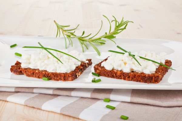 Luxurious black bread slices with cottage cheese on white plate. Healthy eating., Image: 190987940, License: Rights-managed, Restrictions: , Model Release: no, Credit line: Profimedia, Martina Kováčová - com.ilustracni