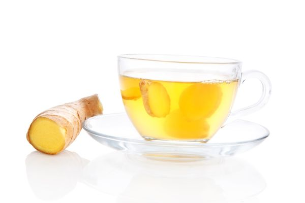 Delicious ginger tea in transparent tea cup with saucer and ginger root and ginger slices isolated on white background. Alternative medicine concept., Image: 191043041, License: Rights-managed, Restrictions: , Model Release: no, Credit line: Profimedia, Martina Kováčová - com.ilustracni