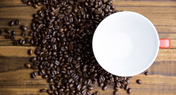 Coffee beans on a table with cup shot in studio, Image: 258236844, License: Royalty-free, Restrictions: , Model Release: no, Credit line: Profimedia, Wavebreak