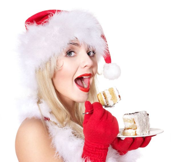 Christmas girl in red Santa hat eating cake on plate. Isolated., Image: 106561087, License: Royalty-free, Restrictions: , Model Release: yes, Credit line: Profimedia, Alamy