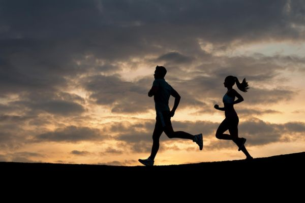 Morning running. Running athletes. Silhouette of runner on evening scamper., Image: 264509404, License: Royalty-free, Restrictions: , Model Release: yes, Credit line: Profimedia, Alamy