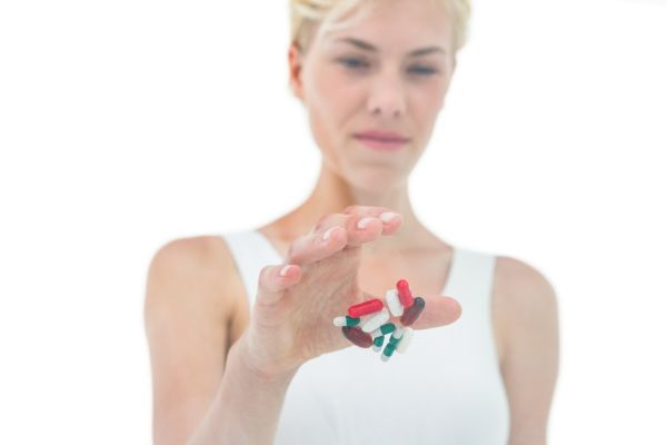 Blonde woman throwing away batch of pills on white background, Image: 253424856, License: Royalty-free, Restrictions: , Model Release: yes, Credit line: Profimedia, Wavebreak