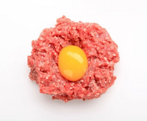 Egg yolk on a nest of raw minced beef, Image: 90024702, License: Rights-managed, Restrictions: , Model Release: no, Credit line: Profimedia, Digifoodstock