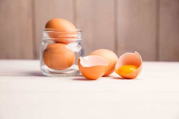 Eggs in a jar by broken egg shells on the table, Image: 260062179, License: Royalty-free, Restrictions: , Model Release: no, Credit line: Profimedia, Wavebreak