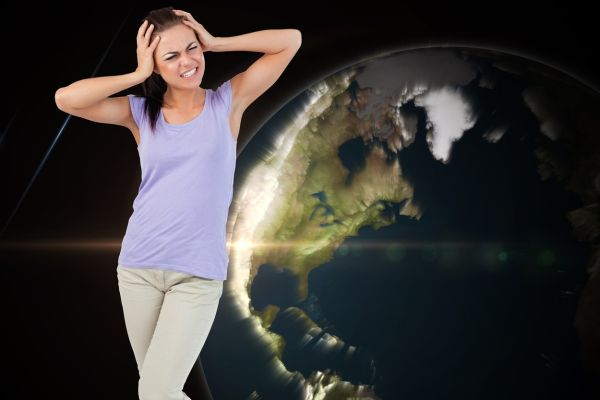 Young female having migraine against glowing earth, Image: 187868393, License: Royalty-free, Restrictions: , Model Release: yes, Credit line: Profimedia, Wavebreak