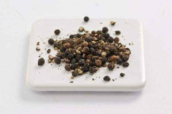 Lightly crushed black peppercorns on white surface  credit: Marie-Louise Avery / thePictureKitchen / TopFoto, Image: 81917278, License: Rights-managed, Restrictions: , Model Release: no, Credit line: Profimedia, thePictureKitchen