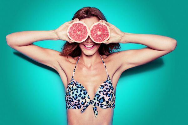 portrait of pretty bikini woman with grapefruit against aqua blue background, Image: 152321654, License: Royalty-free, Restrictions: , Model Release: yes, Credit line: Profimedia, Alamy