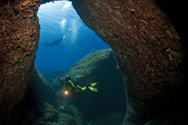 Divers at the entrance to an underwater cave, nature reserve of Dragonera island off Majorca, Balearic Islands, Spain, Mediterranean Sea, Europe, Image: 148175047, License: Rights-managed, Restrictions: , Model Release: no, Credit line: Profimedia, imageBROKER