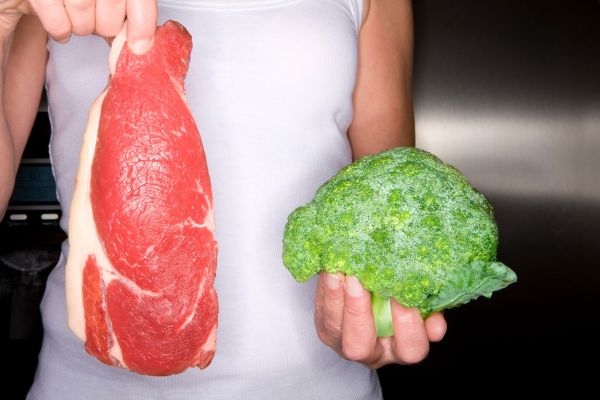 Close up of woman holding fresh meat and frozen broccoli, Image: 14096110, License: Royalty-free, Restrictions: , Model Release: yes, Credit line: Profimedia, Juice Images