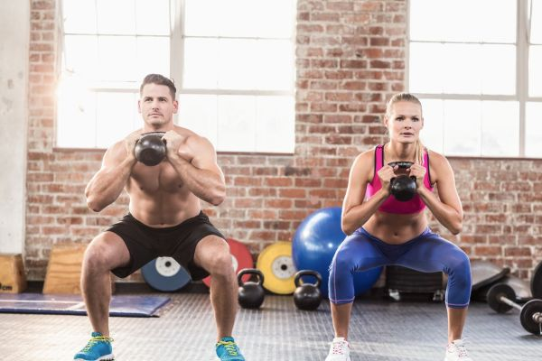 muscular serious couple with kettlebells in crossfit gym, Image: 260063048, License: Royalty-free, Restrictions: , Model Release: yes, Credit line: Profimedia, Wavebreak
