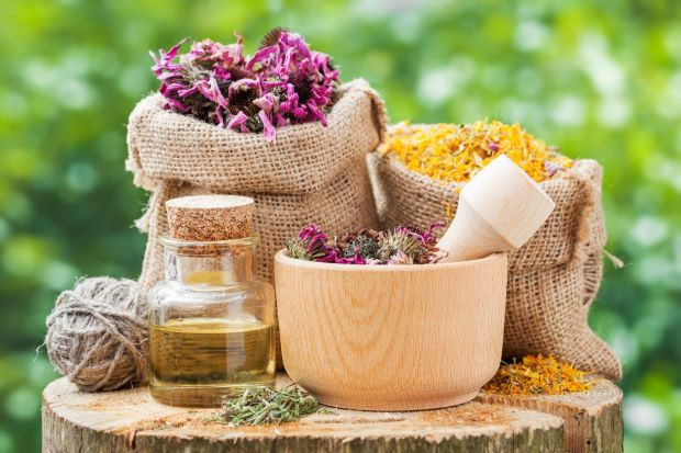 Healing herbs in hessian bags, wooden mortar with coneflowers and essential oil on wooden stump outdoors, herbal medicine., Image: 255695449, License: Royalty-free, Restrictions: , Model Release: no, Credit line: Profimedia, Alamy