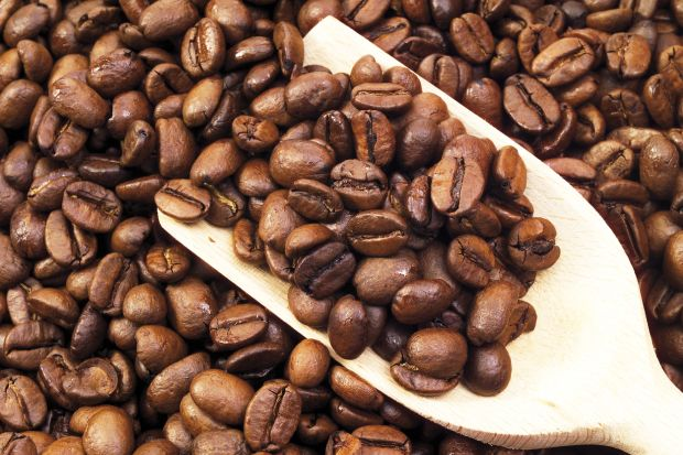 Coffee beans and wooden scoop filling entire image, Image: 43385279, License: Royalty-free, Restrictions: , Model Release: no, Credit line: Profimedia, imageBROKER