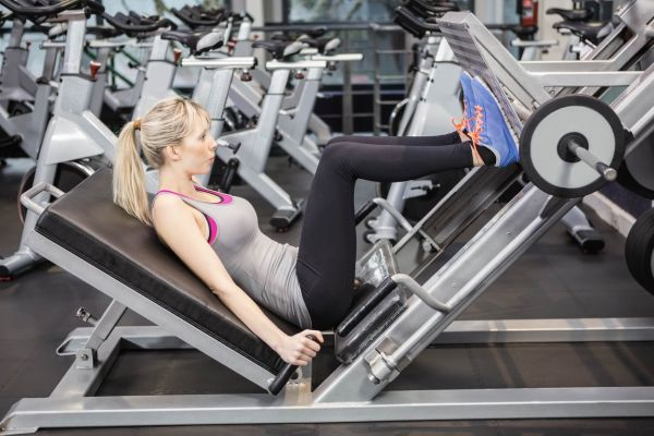 Fit woman using leg press at the gym, Image: 279976602, License: Royalty-free, Restrictions: , Model Release: yes, Credit line: Profimedia, Wavebreak