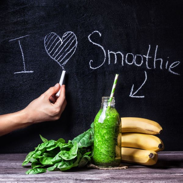 fresh green smoothie with banana and spinach with title i love smoothie on blackboard