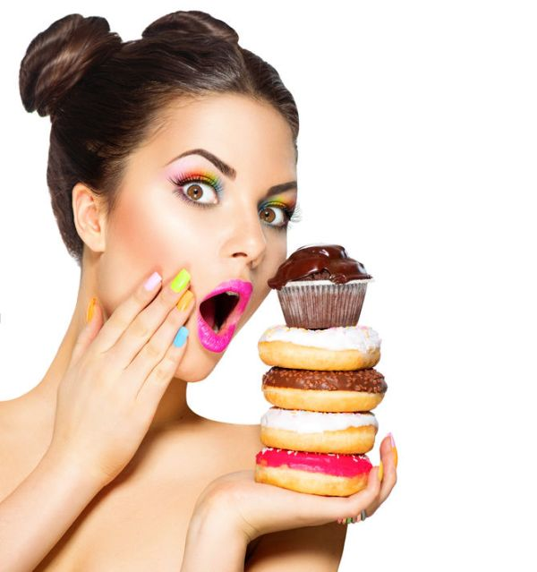 36897586 - beauty fashion model girl taking sweets and colorful donuts
