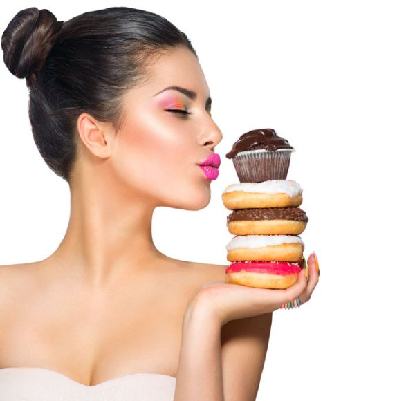 36897627 - beauty fashion model girl taking sweets and colorful donuts
