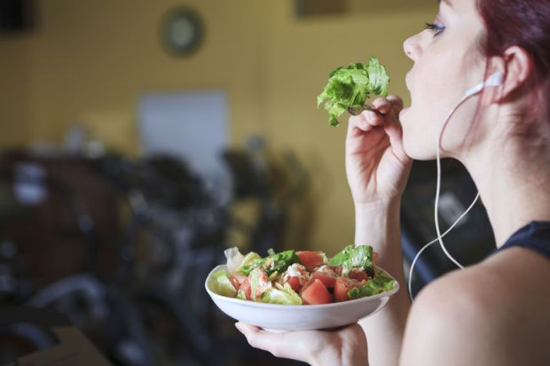 36560581 - gorgeous young woman at the gym eating salad