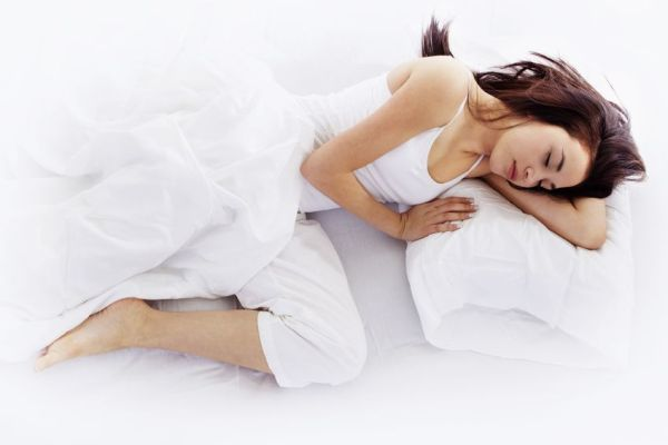 8862576 - stock image of young woman sleeping on white bed