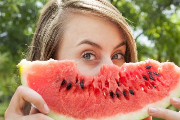 14778724 - young woman with watermelon outdoors