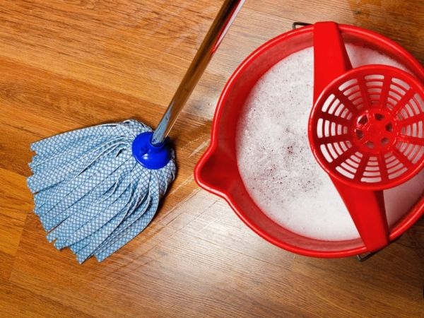 21018397 - top view of mop and bucket with water for cleaning floors