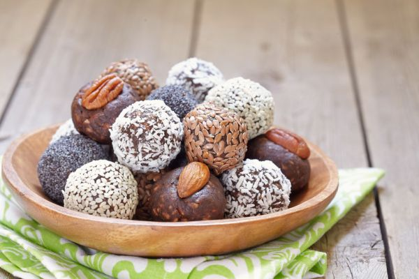 59150657 - homemade healthy paleo raw energy balls with nuts and dates