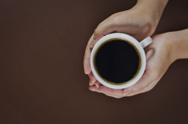 14168224 - woman hand holding a cup of coffee