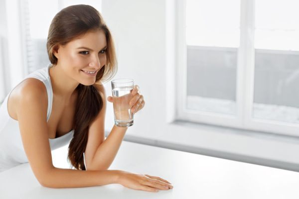 47894993 - healthy lifestyle. portrait of happy smiling young woman with glass of fresh water. healthcare. drinks. health, beauty, diet concept. healthy eating.