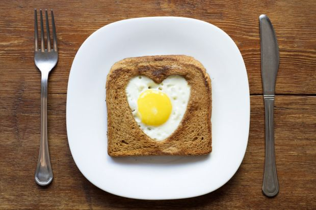 30725631 - fried toast with egg served on white plate
