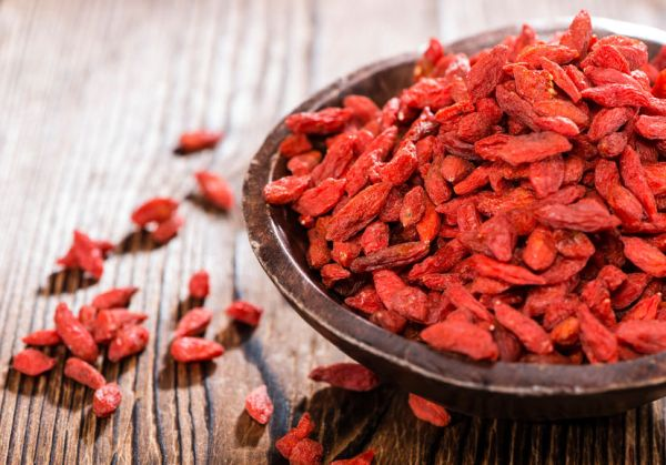30049204 - portion of ried goji berries  in a small bowl