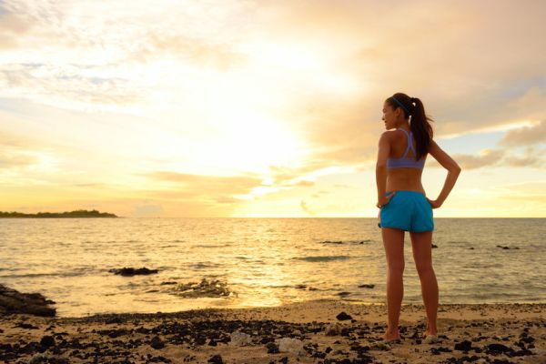 39027347 - aspirations - woman looking away with inspiration. fitness woman after run in sunset on beach looking at ocean feeling peaceful and serene relaxing during summer. mindfulness concept.