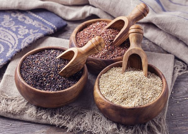 41509795 - red, black and white quinoa seeds on a wooden background