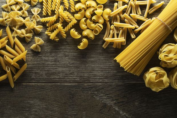 38577468 - pasta collection on rustic wooden background