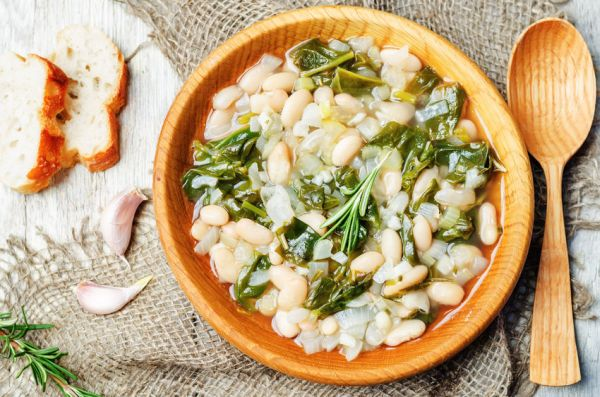 57841314 - rosemary white bean spinach soup. toning. selective focus