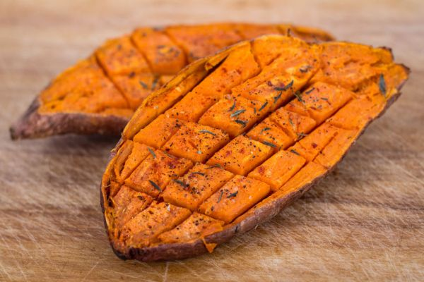 33127360 - baked yam sweet potato
