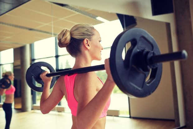 35288252 - fitness, sport, powerlifting and people concept - sporty woman exercising with barbell in gym