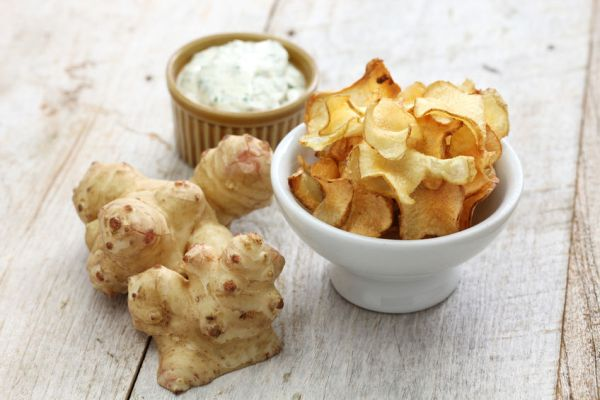 53020869 - homemade jerusalem artichoke chips with dipping sauce