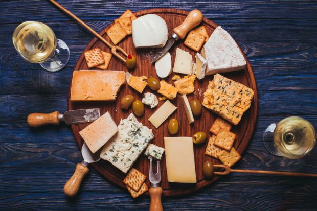 49513543 - pair have a nice evening with cheese plate and wine