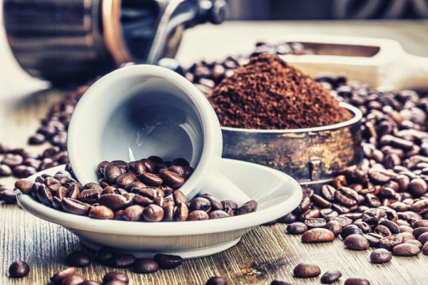 38324890 - coffe beans , cup of coffee and grinder