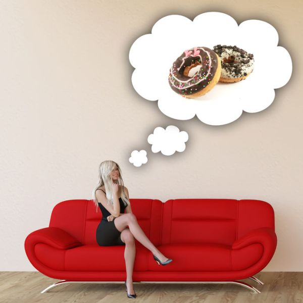 53097099 - woman craving donuts and thinking about eating food