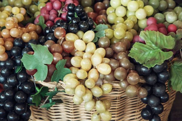 44255654 - mix of various grapes in wicker baskets.