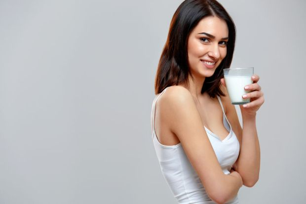 45823624 - happy young woman drinking milk