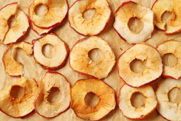 25083480 - apple chips on baking parchment paper