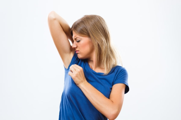 44034920 - young woman is sweating to much and she doesn't like her smell under armpit.