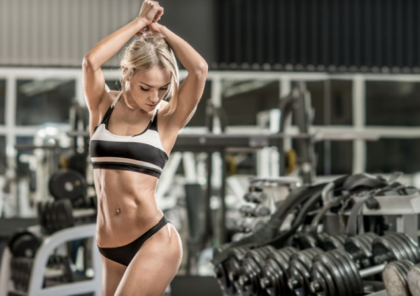 48713426 - young fitness woman in gym, horizontal photo
