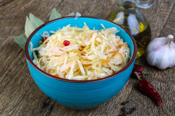 49275647 - fermented cabbage - sauerkraut with herbs and spices on the wood background