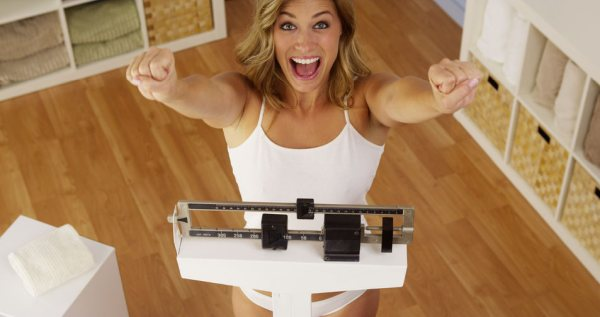 33837832 - happy woman celebrating weight loss
