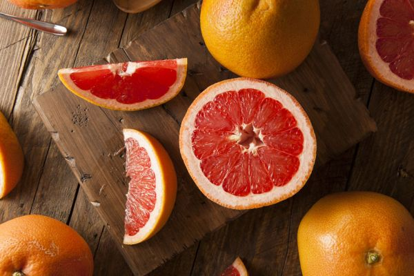 35958512 - healthy organic red ruby grapefruit on a background